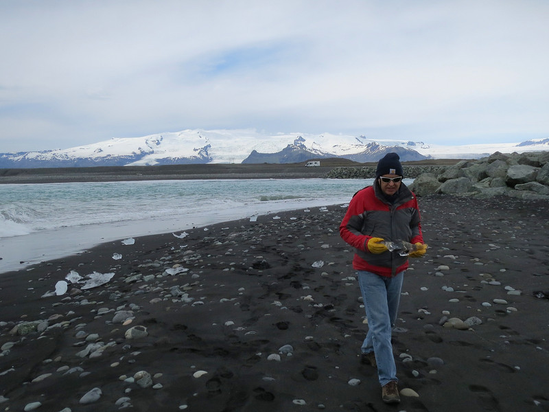 Steve holding a thousand-year-old piece of ice which he broke up and put in his water bottle.