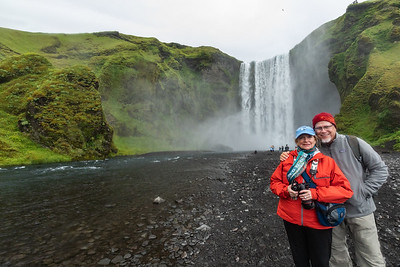 Skógafoss,  a waterfall on the Skógá River in the south of Iceland.  The Skógafoss is one of the biggest waterfalls in Iceland with a width of 49 feet and a drop of 200ft.