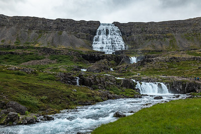 Dynjandi, also known as Fjallfoss, is a series of six waterfalls located in the Westfjords, Iceland. The Icelandic term 'dynjandi' means thunder or resounding.  Dynjandi is the biggest waterfall in the Westfjords. It is located by Dynjandisvogur bay on Arnarfjörður fjord. Dynjandi has a total height of 330 feet.