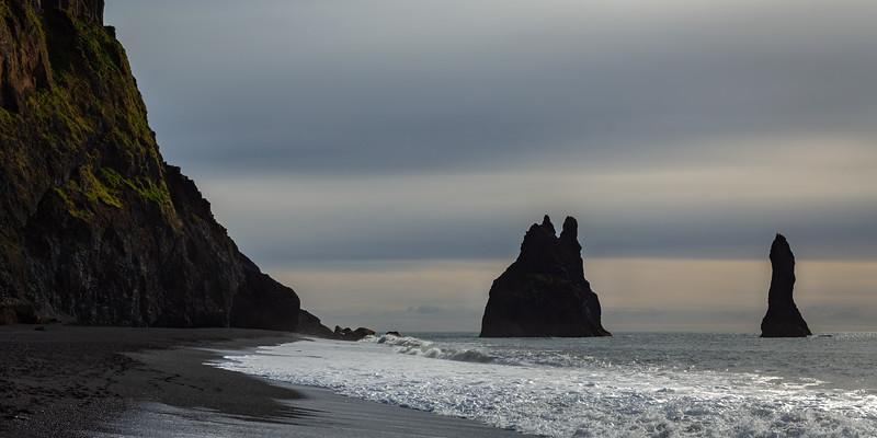 Reynisfjara beach and the impressive Reynisdrangar rock formations (basalt sea stacks)