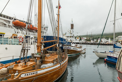Húsavík harbor,   Húsavík is located in northern Iceland on Skjálfandi bay.  It has 2,182 inhabitants.