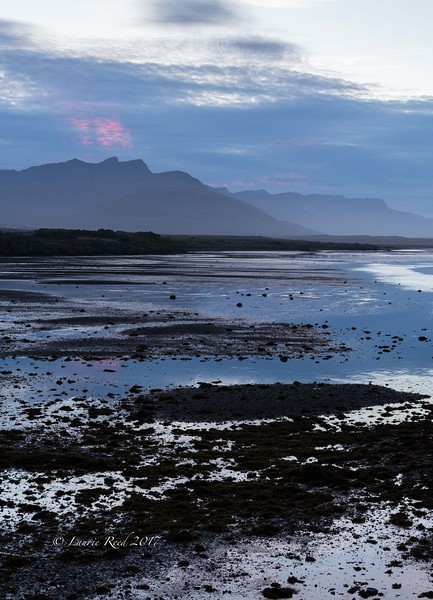 Sunset colors in the tidal flats near the town of Breiðdalsvik