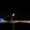 Reykjavik harbor under crescent moon
