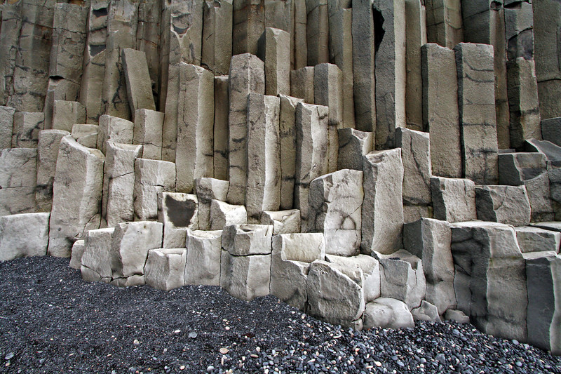 Columnar basalt formations on the beach.