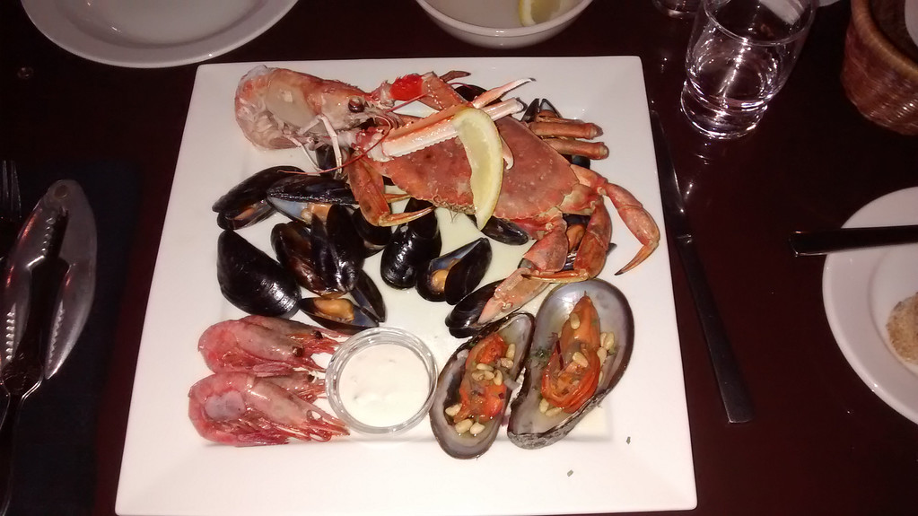 The Seafood Plate at Vitinn - lobster, crab, shrimp, mussels and horse shoe mussels with homemade bread and icelandic butter.