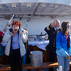 Ships captain assists during the Arctic Circle crossing ceremony