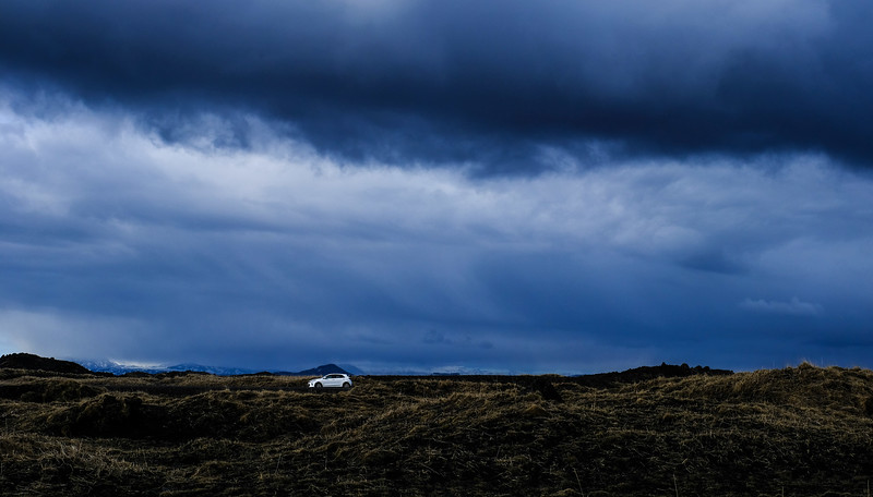 car beneath the clouds in iceland