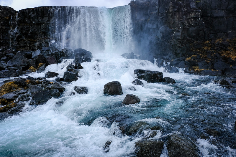 The magnificent water fall at Thingellvir ( or Pingellvir) crashes onto the rocks. This is the place democracy was born in Iceland.