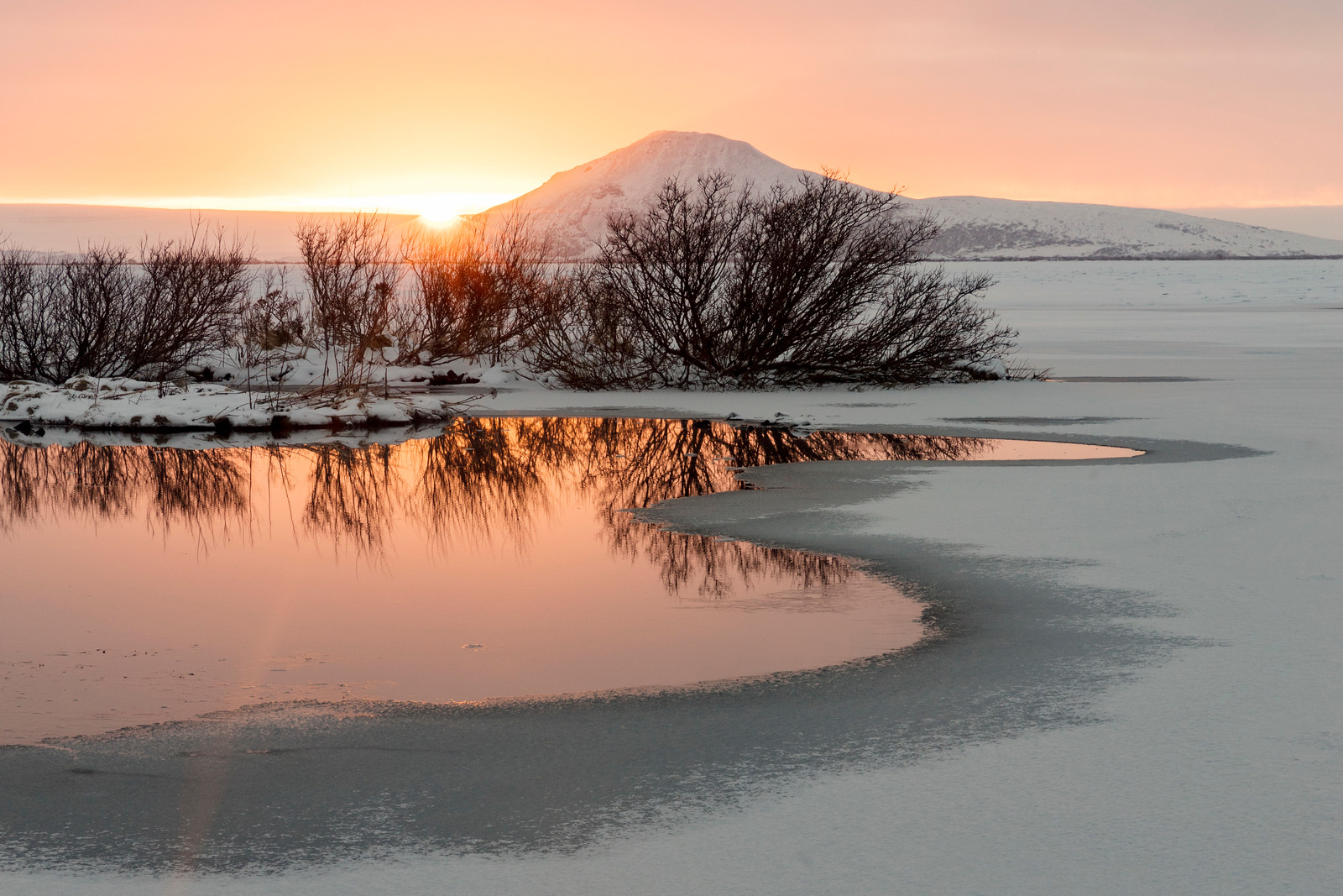 With beautiful warmm colors on a frozen landscape