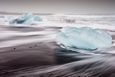 The swirling waters of the Atlantci routinely through these icebergs back on the shore