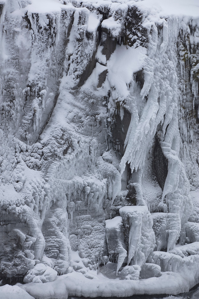 Accompanied in winter by dramatic frozen shapes  Do you see the face breathing out the freezing air in the left hand side?