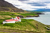 Farm buildings on the plains beside the  Eyjafjörður fjord, near Akureyri, Iceland, Europe.