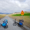 Turning onto the gravel road leading to Gjáin -testing the limit of our cheap foldable bikes