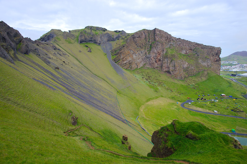 Hiking along the ridge of the extinct volcano at Herjólfsdalur (our campsite below)