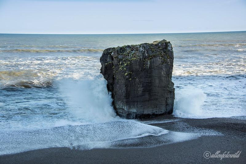 Basaltic pillar on black sand beach, Laekjavik, East Fjords, Iceland