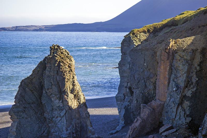 Cliffs and black sand beaches