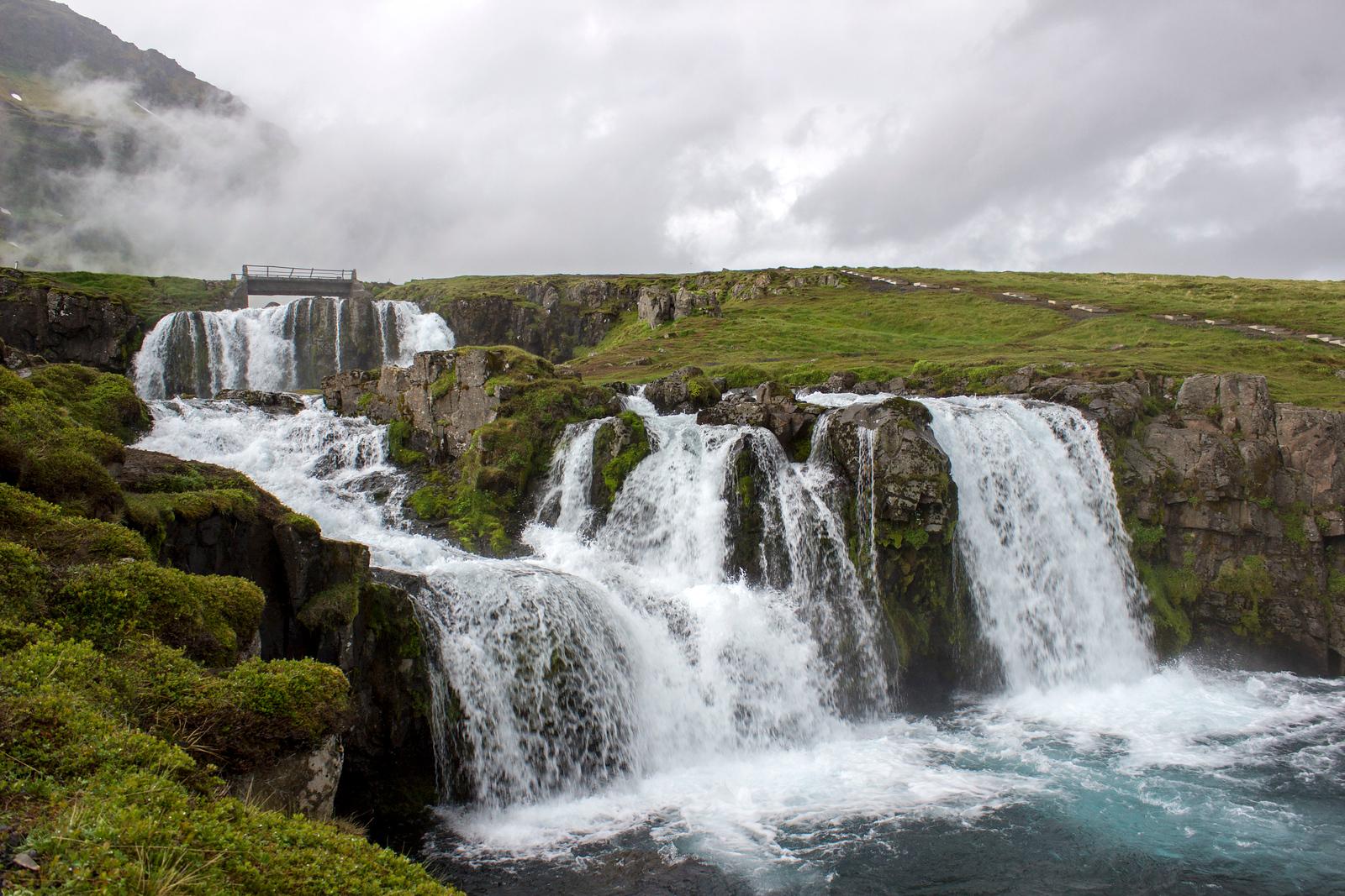 Kirkjufell waterfalls. Snæfellsnes Peninsula Iceland Day Trip Travel Guide.