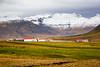 A farm in a mountain valley near Grundarfjordur, Iceland.