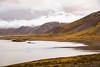 Lake and snow capped mountain landscape near Grundarfjordur, Iceland.