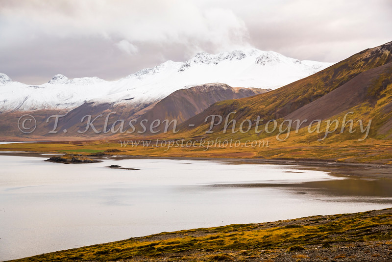 Lake and snow capped mountain landscape near Grundarfjordur, Iceland.