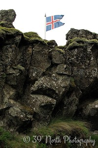 The flagpole marks the spot of the Löberg (Law Rock) where the Law Speaker stood to recite the laws during sessions of the Alþing.
