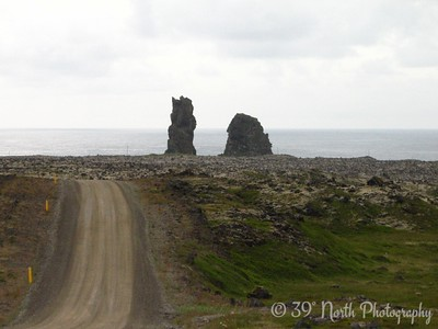 "Londrangar pillars - the taller one is known locally as ""Christian pillar"" and the shorter one as ""Heathen pillar"""