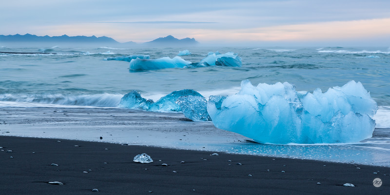 Black sand, blue ice