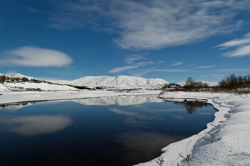 Þingvellir on a cold winter night. The sky is being reflected in the still ice cold water.