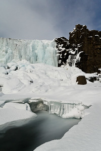 Öxarárfoss, wearing an armor of ice.