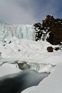 Öxarárfoss, wearing an armor of ice.