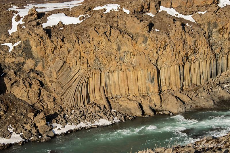 Columnar basalt columns on Skjálfandafljót river below Aldeyjarfoss Falls, Bardardalur valley, Iceland