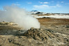 Steaming fumerole with the Hverfjall tephra ring volcano in the background, Hverir, Myvatn, Iceland