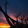 The setting midnight sun, viewed from Reykjavík's the iconic boat sculpture Sólfarið  (the Sun Voyager)