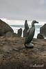 Stormy seas, pinnacles and great auk statue (Pinguinus impennis), Reykjanes Peninsula, Iceland