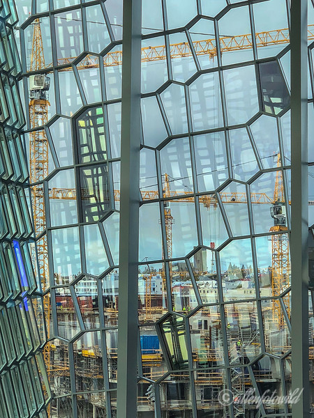 View of Reykjavik through the foyer windows of the Harpa Concert Hall, Iceland