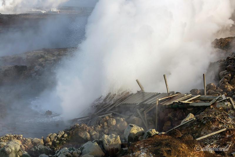 Gunnuhver geothermal hot springs with Svartsengi power plant in distance, Reykjanes Peninula, Iceland