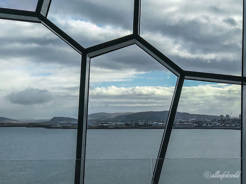 View of Reykjavik waterfront though the foyer windows of the Harpa Concert Hall, Iceland