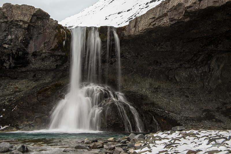 Kvernufoss with snow, long exposure, Kverna River, Iceland