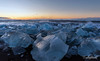 Sunrise and jumbled ice in high winds at Diamond Beach, Jökulsárlón, Iceland