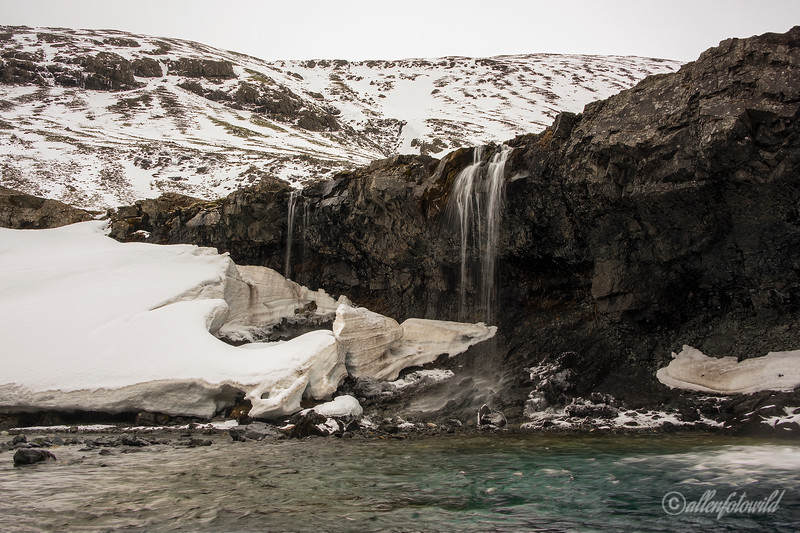 Water sculpted snow at the Kvernufoss falls, Kverna River, Iceland