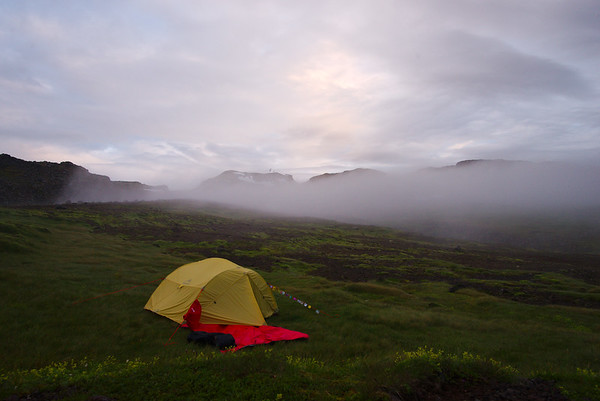 As we readied for bed the fog lifted momentarily exposing the tip of the  Snæfellsjökull Glacier as well as the lush green spot that we had selected for camping (without having known it)