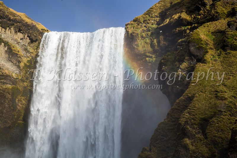 The Skogafoss waterfall with a rainbow in southern Iceland.