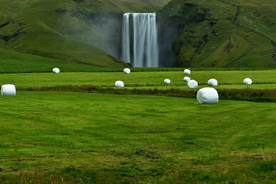 Wrapped Bales with Skogarfoss in background
