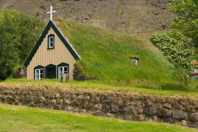 Old church in Iceland has a roof of grass.