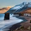 Seastack and Waves along Rocky Coastline