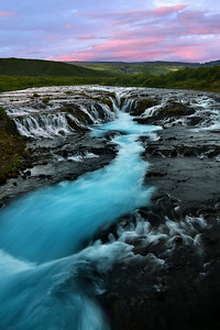 Vertical view of Bruarfoss at sunset, Brekkuskógur, Iceland