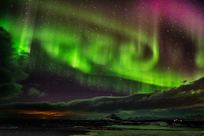 "The Glow of the Northern Lights, a/k/a ""Aurora Borealis"", high above the volcanos of Iceland"