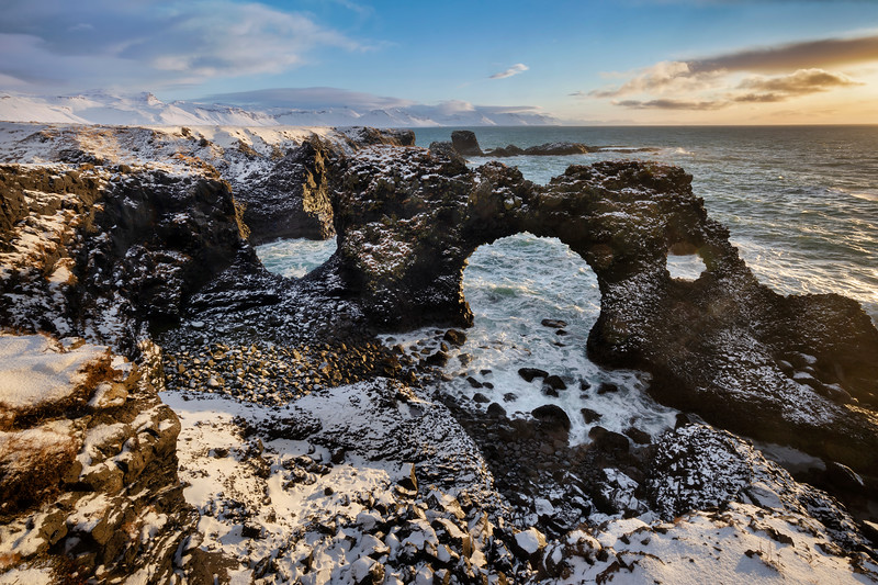 Basalt stone arch of Gatklettur at sunrise