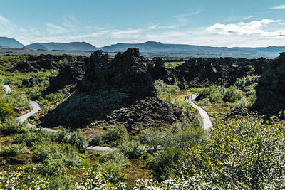 People Hiking on the Winding Trail Through the Dimmuborgir Lava Fields in Northern Iceland