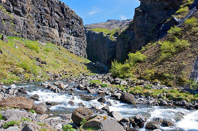 A crevice in the earth leading to Iceland's highest waterfall.